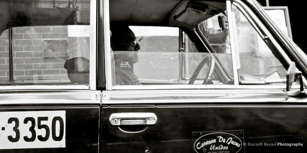 A taxi driver waits for a fare in Lima, Peru