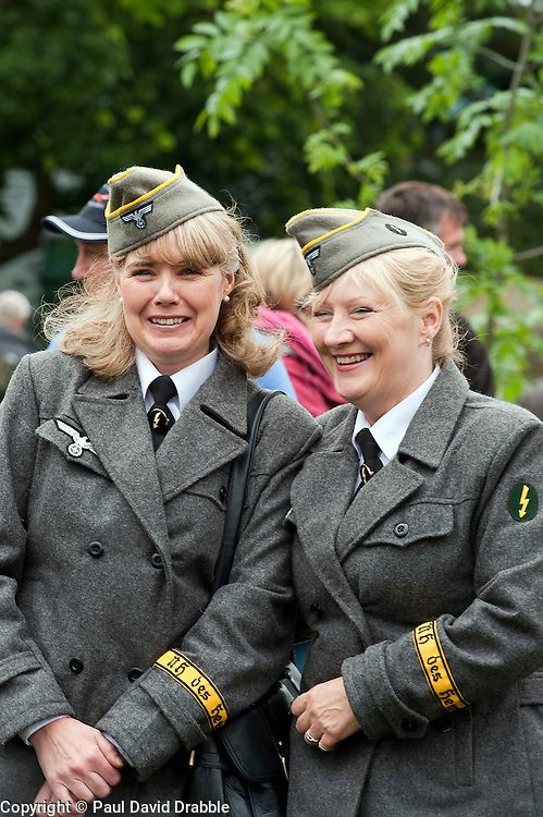reenactors dressed as German army female signals auxiluaries (Nachrichtenheflrennin des heeres) also nicknamed Blitzm&auml;dchen or lightening girls because of the signals insignia on their uniforms, at Northallerton Wartime Weekend is a fund raising event that happens throughout the Yorkshire market town of Northallerton. .With help of volunteers and local business it has been successful in raising money for the charities.Help for Heroes.Royal British Legion.Bomber Command Memorial Charity .Ben Hyde Memorial Fund.<br /> 16/17 June 2012<br /> Image &copy; Paul David Drabble
