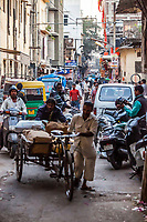 A busy street scene in a street market. Jaipur, Rajasthan, India.