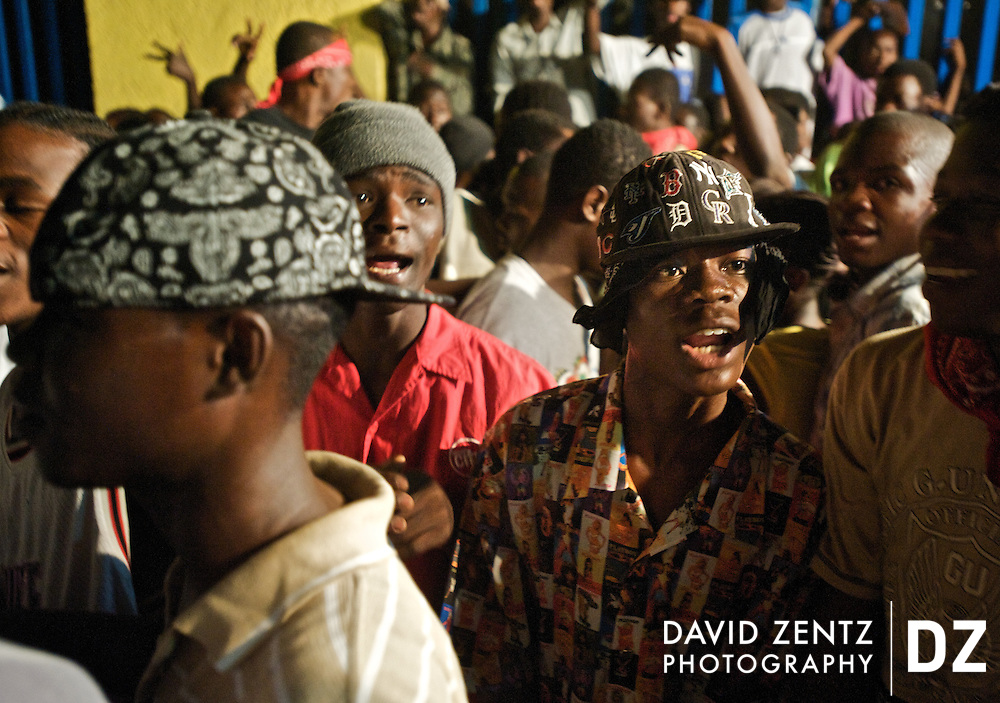 Young men wear hip-hop fashion at a ti sourit, an all niight block party, in Port-au-Prince, Haiti on July 13, 2008. Hip-hop and Rap Kreyol have taken off in Haiti in recent years, fueled most recently by the death of three members of the rap group Barikad Crew, who died in a car accident in mid-June.