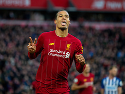LIVERPOOL, ENGLAND - Saturday, November 30, 2019: Liverpool's Virgil van Dijk sticks out his tongue as he celebrates scoring the second goal, his second of the game, during the FA Premier League match between Liverpool FC and Brighton & Hove Albion FC at Anfield. Liverpool won 2-1. (Pic by David Rawcliffe/Propaganda)