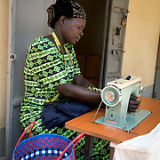 Uganda . Moyo. Joyce Eimani , village tailor. Joyce has a physical disability caused by childbirth.