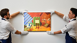 "© Licensed to London News Pictures. 27/09/2019. LONDON, UK.  Technicians present ""Bridlington Studio Interior"", 1996, by David Hockney (Est. GBP 0.9-1.2m).  Preview of Sotheby's Frieze Week Contemporary Art exhibition at its New Bond Street galleries.  Over 250 works by artists, including Andy Warhol, David Hockney and Jean-Michel Basquiat, will be auctioned on 3 October 2019.  Photo credit: Stephen Chung/LNP"