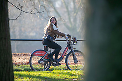 © Licensed to London News Pictures. 30/12/2019. London, UK. A cyclist enjoys an unseasonably mild sunny day in Hyde Park, London as forecasters predict warm weather and possibly the the warmest New Year's Eve for over a 170 years. Photo credit: Alex Lentati/LNP