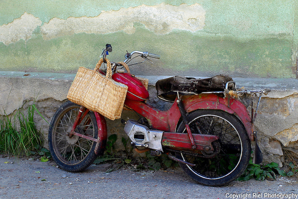 The old gentleman that owned this motorcycle wanted several Kuna for the privilege of taking this picture. Money well spent.