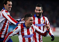Atletico de Madrid´s J. M. Gimenez celebrates a goal with Diego Godin and Arda Turan during 2014-15 `Copa del Rey´ Spanish Cup match at Vicente Calderon stadium in Madrid, Spain. January 07, 2015. (ALTERPHOTOS/Victor Blanco)