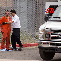 072315       Cable Hoover<br /> <br /> Emergency medical personnel tend to an inmate at an impromptu triage space on the east side of the McKinley County Detention Center during a disturbance Thursday.