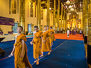 "03 APRIL 2016 - CHIANG MAI, THAILAND: Novices, young Buddhist monks, leave the ""viharn"" or prayer hall after a meditation and prayer ceremony at Wat Chedi Luang in Chiang Mai. The meditation ceremony was in honor of the birthday of Her Royal Highness Princess Maha Chakri Sirindhorn, the daughter of Bhumibol Adulyadej, the King of Thailand. The Princess was born on April 2, 1955. She is revered by Thais and special ceremonies in her honor are held in temples throughout Thailand.     PHOTO BY JACK KURTZ"