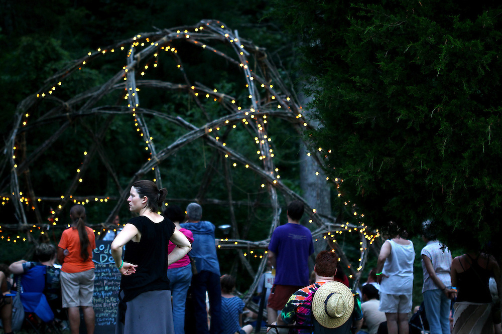 A group gathers to hear a speaker at the geodesic dome at the Wild Goose Festival at Shakori Hills in North Carolina June 24, 2011.  (Photo by Courtney Perry)