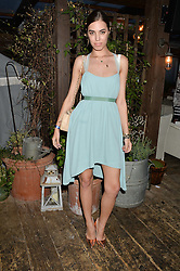 AMBER LE BON at the Warner Music Group & GQ Summer Party held at Shoreditch House, Ebor Street, London on 17th July 2014.