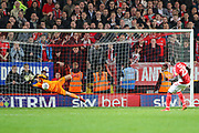 Doncaster Rovers goalkeeper Marko Marosi (13) saves a penalty kick by Charlton Athletic defender Mouhamadou-Naby Sarr (23) during the EFL Sky Bet League 1 second leg Play-Off match between Charlton Athletic and Doncaster Rovers at The Valley, London, England on 17 May 2019.