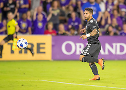 April 21, 2018 - Orlando, FL, U.S. - ORLANDO, FL - APRIL 21: Orlando City forward Dom Dwyer (14) watches his 100th MLS goal go in the net during the MLS soccer match between the Orlando City FC and the San Jose Earthquakes at Orlando City SC on April 21, 2018 at Orlando City Stadium in Orlando, FL. (Photo by Andrew Bershaw/Icon Sportswire) (Credit Image: © Andrew Bershaw/Icon SMI via ZUMA Press)