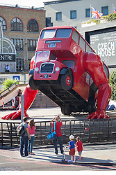 © licensed to London News Pictures. London, UK 23/07/2012. The double-decker bus which has arms and does push ups outside Business Design Centre. The London Booster designed by Czech artist David Cerny. It will perform outside Czech Team's Olympics headquarters in London during the Olympics. Photo credit: Tolga Akmen/LNP