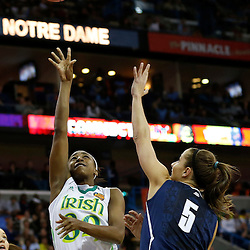 April 7, 2013; New Orleans, LA, USA; Notre Dame Fighting Irish guard Jewell Loyd (32) shoots against Connecticut Huskies guard Caroline Doty (5) during the first half in the semifinals during the 2013 NCAA womens Final Four at the New Orleans Arena. Mandatory Credit: Derick E. Hingle-USA TODAY Sports