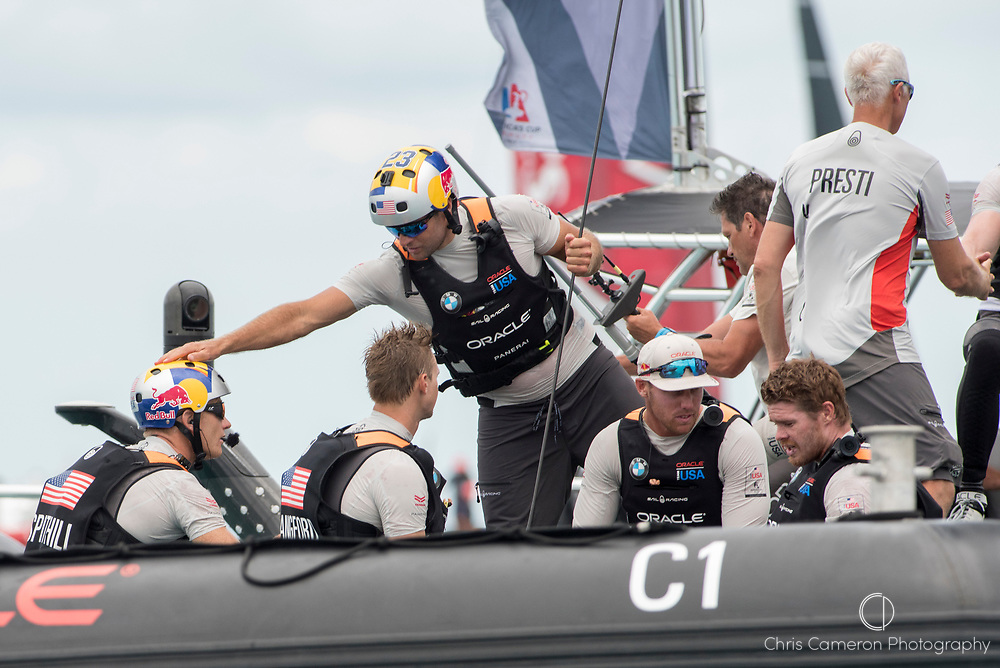 The Great Sound, Bermuda, 24th June 2017, Tom Slingsby gives Jimmy Spithill a pat on the helmet after Oracle Team USA beats Emirates Team New Zealand  in race six. Their first win of the regatta. Day three of racing in the America's Cup presented by louis Vuitton.