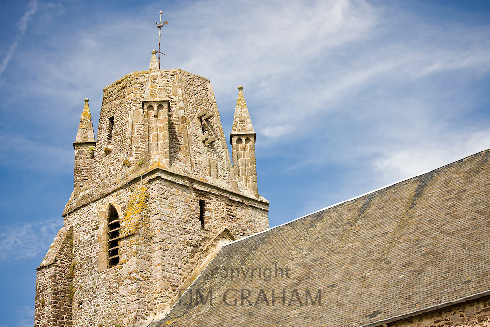 Norman church with unusual rounded square tower in Regneville-Sur-Mer in Normandy, France