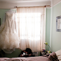 Erin's dress hangs in her room before her Brooklyn wedding.