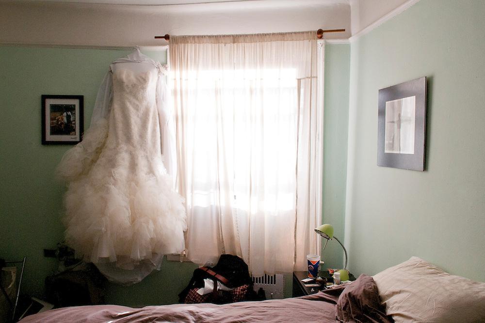 Erin's dress hangs in her room before her Brooklyn wedding.