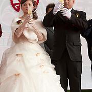 Bride and groom toast their guests at a wedding in Namasiya Township, Kaoshiung County, Taiwan.