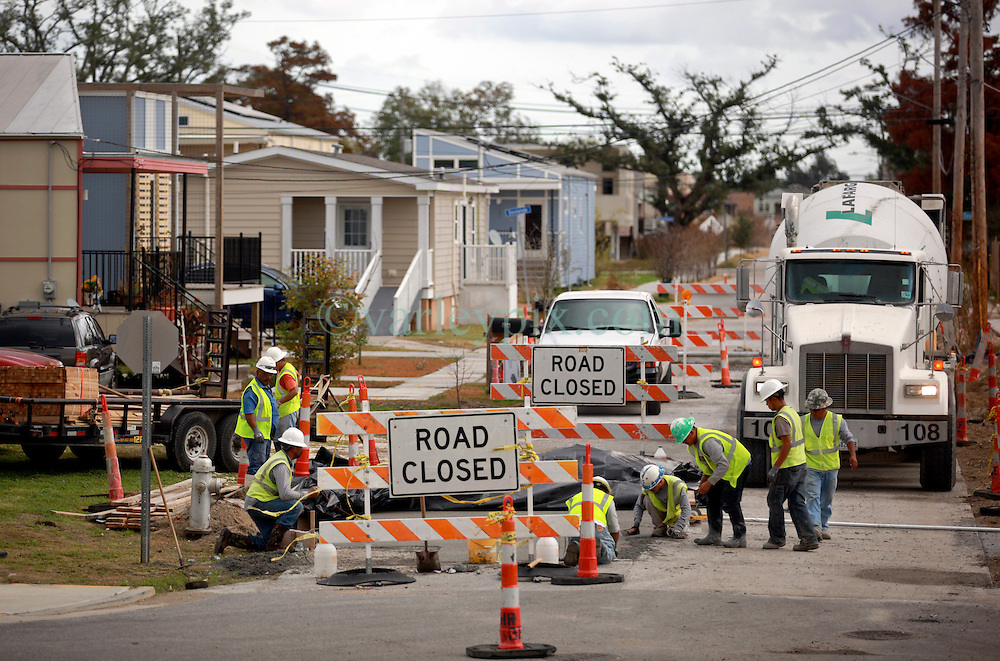 03 December 2013. Lower 9th Ward, New Orleans, Louisiana. <br /> Road construction amongst the Brad Pitt 'Make it Right' homes. <br /> Photo; Charlie Varley