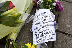 © Licensed to London News Pictures. 08/03/2019. Fulham, London, UK. A note pinned to flowers left in Lanfrey Place where 17yr old Ayub Hassan died of stab wounds sustained in an attack yesterday afternoon. Four teenagers have been arrested in connection with the murder, the investigation continues. Photo credit: Guilhem Baker/LNP