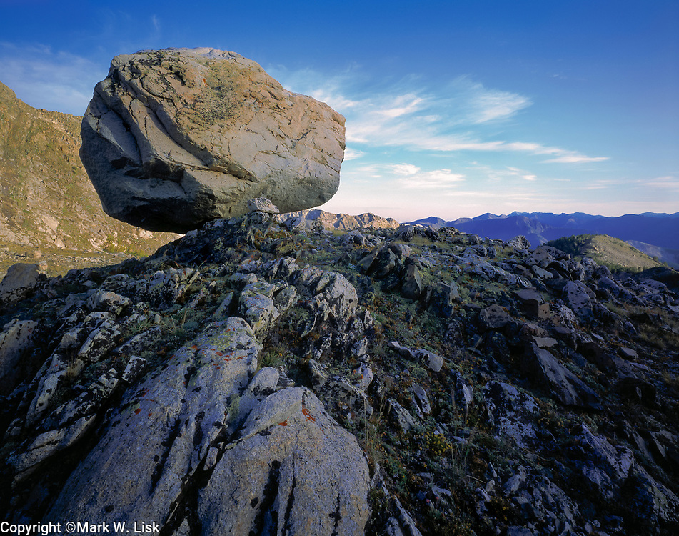A giant boulder rests on a ridgeline at the top of  Broad Canyon in Idaho's Pioneer Mountain Range.