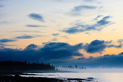 Morning clouds at dawn at Seawall in Maine's Acadia National Park.
