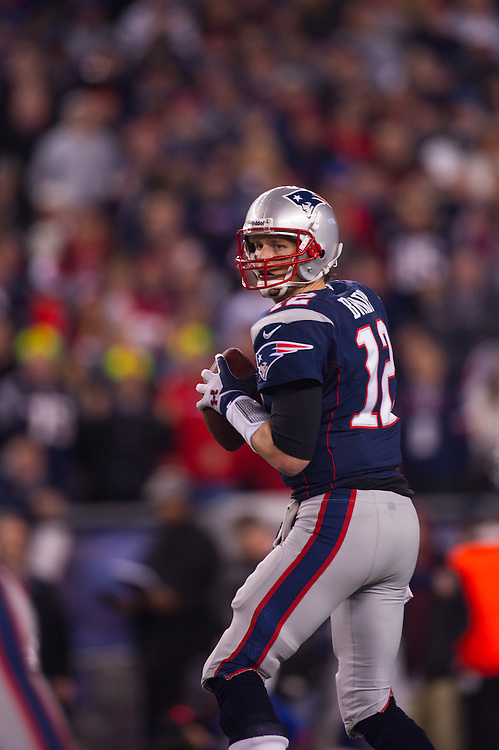 FOXBORO, MA - JANUARY 13:  Quarterback Tom Brady #12 of the New England Patriots drops back to pass during the AFC Divisional Playoff against the Houston Texans at Gillette Stadium on January 13, 2013 in Foxboro, Massachusetts.(Photo by Rob Tringali) *** Local Caption *** Tom Brady