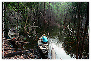 Amazonia, Brazil 030504  A fisherman prepares to launch his canoe into a flooded jungle area in Amazonia. (Essdras M Suarez/ Globe Staff)
