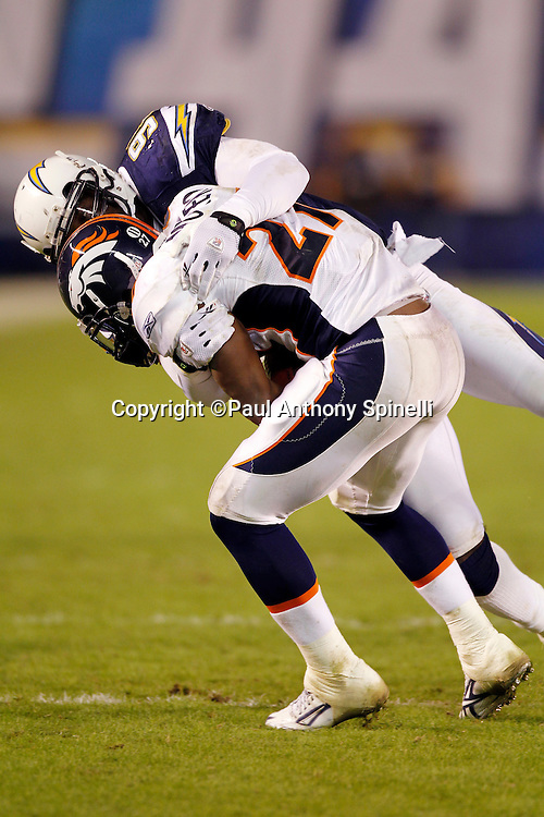 Denver Broncos running back Knowshon Moreno (27) gets hit by San Diego Chargers linebacker Kevin Burnett (99) during the NFL week 11 football game against the San Diego Chargers on Monday, November 22, 2010 in San Diego, California. The Chargers won the game 35-14. (©Paul Anthony Spinelli)