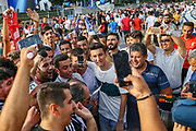 A TV Reporter finds himself surrounded by fans ahead of  the 2019 UEFA Super Cup Final between Liverpool and Chelsea at BJK Vodafone Park, Besiktas, İstanbul, Turkey on 14 August 2019.