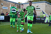 Forest Green Rovers Ebou Adams(14) with mascot during the EFL Sky Bet League 2 match between Forest Green Rovers and Mansfield Town at the New Lawn, Forest Green, United Kingdom on 19 October 2019.