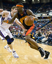 November 8, 2009; Sacramento, CA, USA;  Golden State Warriors forward Stephen Jackson (1) dribbles past Sacramento Kings forward Andres Nocioni (5) during the first quarter at the ARCO Arena. The Kings defeated the Warriors 120-107.
