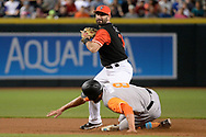 PHOENIX, AZ - AUGUST 27:  Daniel Descalso #3 of the Arizona Diamondbacks turns the double play over Hunter Pence #8 of the San Francisco Giants after making the force out at second in the first inning at Chase Field on August 27, 2017 in Phoenix, Arizona.  (Photo by Jennifer Stewart/Getty Images)