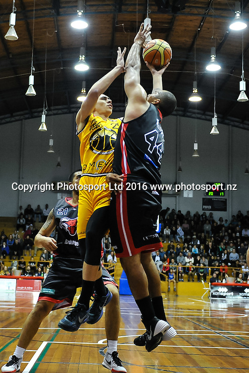 Tony Tolovae of the Taranaki Mountainairs  gets blocked by Marques Whippy of the Rams during the NBL Basketball Match, Canterbury Rams V Taranaki Mountainairs, Cowles Stadium, Christchurch, New Zealand. 17th March 2016. Copyright Photo: John Davidson / www.photosport.nz