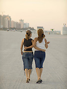 two women walking in the evening on the beach Miami USA