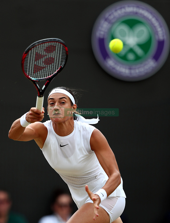 Caroline Garcia in action against Johanna Konta on day seven of the Wimbledon Championships at The All England Lawn Tennis and Croquet Club, Wimbledon.