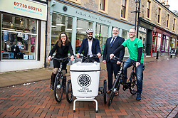 Pictured: Clara Walker, Forth Environment Link Chief Executive, Humza Yousaf, Pete Reid, Growth & Investment Manager and Ray Burr, Falkirk Active Travel Hub Coordinator get on their bikes<br /> Transport minister Humza Yousaf MSP opened Falkirk's active travel hub. The resource will encourage people to make healthier, greener travel choices. <br /> <br /> <br /> Ger Harley | EEm 6 February 2018