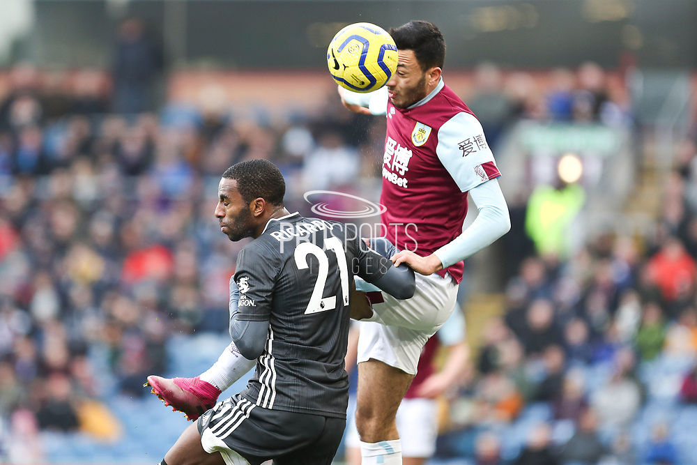 Burnley midfielder Dwight McNeil challenged by Leicester City defender Ricardo Pereira during the Premier League match between Burnley and Leicester City at Turf Moor, Burnley, England on 19 January 2020.