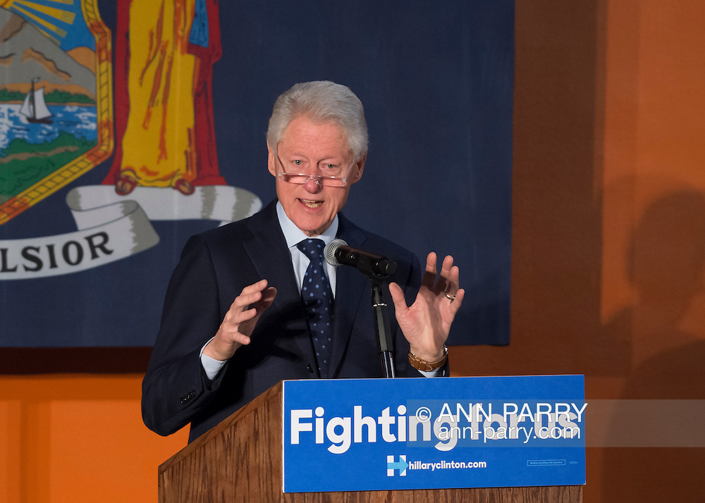 Elmont, New York, USA. April 5, 2016. Former President Bill Clinton, wearing reading glasses, is the headline speaker as he campaigns at an Organizing Event rally in Elmont, Long Island, on behalf of his wife, Hillary Clinton, the leading Democratic presidential candidate, and former Secretary of State and U.S. Senator for New York. The New York Democratic Primary takes place April 19th.