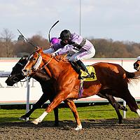 Triple Dream and Richard Kingscote winning the 1.50 race
