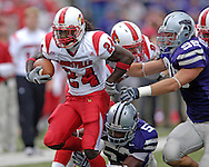 Louisville running back George Stripling (24) rushes past Kansas State defenders Ian Campbell (98) and Zach Diles (52) in the second half, at Bill Snyder Family Stadium in Manhattan, Kansas, September 23, 2006.  The 8th ranked Louisville Cardinals beat K-State 24-6.