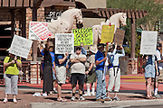 Aug. 8, 2009 -- SCOTTSDALE, AZ: People line Scottsdale Rd during a protest against the Obama health care plan in Scottsdale, AZ.  Nearly 1,000 people opposed to the President Barack Obama's health care reform efforts picketed the offices of Congresman Harry Mitchell (D-AZ) in Scottsdale, AZ, Saturday. The protest was organized by conservative groups who are organizing similar protests against President Obama across the US. Ostensibly concerned mostly with health care reform, it was also a protest against almost everything related to the Obama administration. Photo by Jack Kurtz