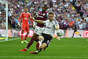 Fulham midfielder Kevin McDonald (6)  clears the ball under pressure from Aston Villa striker Jonathan Kodjia (22) during the EFL Sky Bet Championship play-off final match between Fulham and Aston Villa at Wembley Stadium, London, England on 26 May 2018. Picture by Dennis Goodwin.
