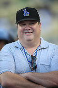 LOS ANGELES, CA - AUGUST 22:  Actor  Eric Allen Stonestreet, co-star of the comedy television series Modern Family, smiles as he chats on the field before the Los Angeles Dodgers game against the New York Mets at Dodger Stadium on Friday, August 22, 2014 in Los Angeles, California. The Dodgers won the game 6-2. (Photo by Paul Spinelli/MLB Photos via Getty Images) *** Local Caption *** Eric Allen Stonestreet