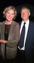 Top designer & restaurant owner SIR TERENCE CONRAN<br />  and his companion MISS VICTORIA DAVIS, at a dinner in<br />  London on 22nd May 2000.OEK 130