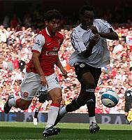 Photo: Steve Bond.<br />Arsenal v Derby County. The FA Barclays Premiership. 22/09/2007. Eduardo (L) attacks Claude Davis (R)