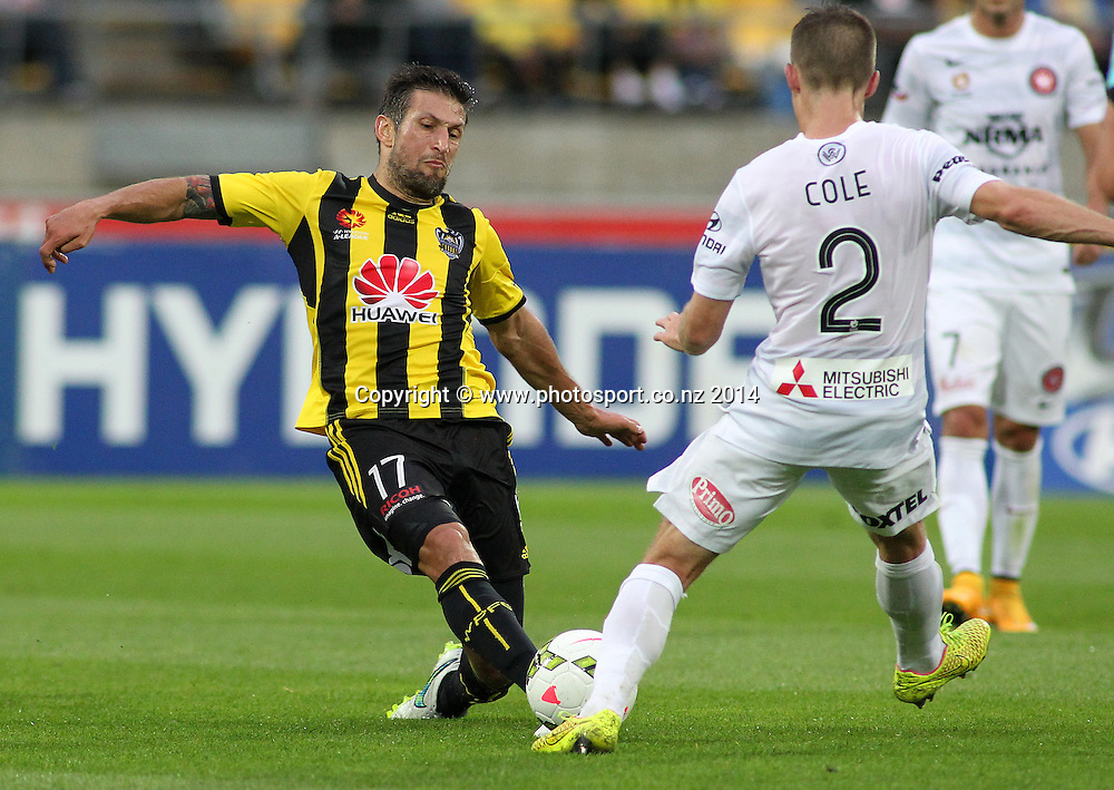 Phoenix Vince Lia dives in to save a loose ball during the A-League football match between the Wellington Phoenix & Western Sydney Wanderers at Westpac Stadium, Wellington, 28 December 2014. Photo.: Grant Down / www.photosport.co.nz