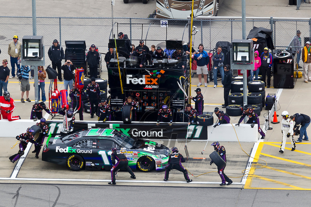 KANSAS CITY, KS - APR 22, 2012:  Denny Hamlin (11) races during the STP 400 at the Kansas Speedway in Kansas City, KS.