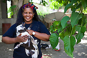 Haika Mshomi in her compound with one of her ducks.<br /> <br /> Haika set up and now runs a poultry business selling chickens, their eggs and also ducks, Mail Mojo Soweto, Tanzania.<br /> <br /> She attended MKUBWA enterprise training run by the Tanzania Gatsby Trust in partnership with The Cherie Blair Foundation for Women.